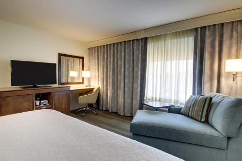 A television and/or entertainment center at Hampton Inn & Suites Milwaukee West