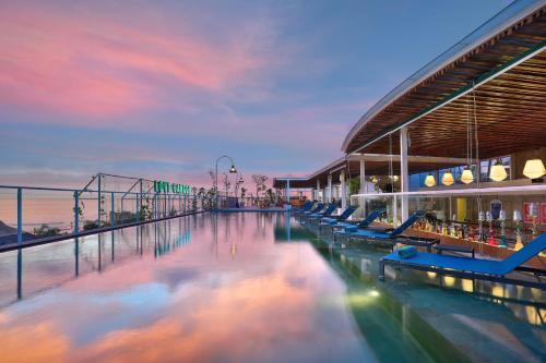 The swimming pool at or near Aston Canggu Beach Resort