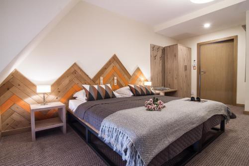 Łóżko lub łóżka w pokoju w obiekcie Novobilski