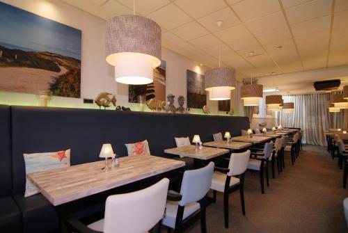 Een restaurant of ander eetgelegenheid bij Hotel de Burg