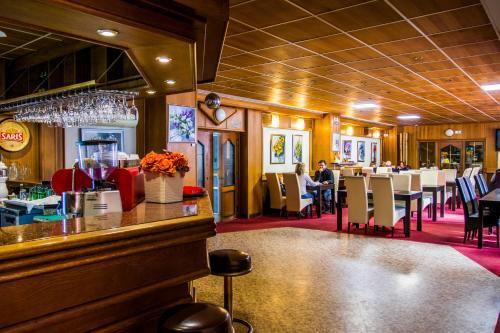 Reštaurácia alebo iné gastronomické zariadenie v ubytovaní Hotel Kamei