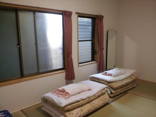 A bed or beds in a room at Mimatsuso