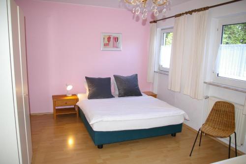 Ein Bett oder Betten in einem Zimmer der Unterkunft Ferienhaus Waldrand