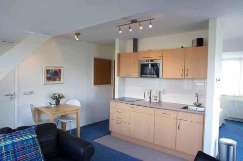 Cuisine ou kitchenette dans l'établissement Appartementen Bergen aan Zee de Schelp