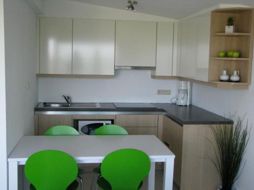 A kitchen or kitchenette at Appartement Iris