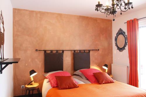 Un ou plusieurs lits dans un hébergement de l'établissement Chambres d'hôtes Souffle Nature