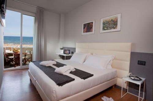 Кровать или кровати в номере Hotel Ascot & Spa