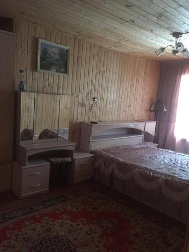 Кровать или кровати в номере Гостевой Дом в Кузяево