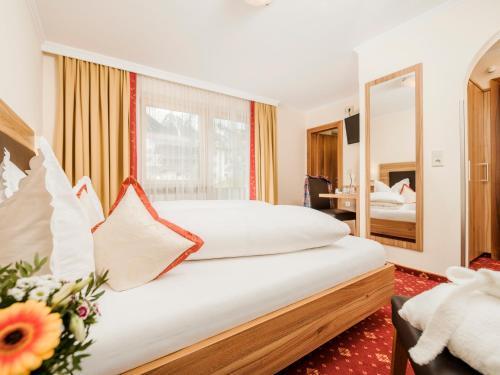 Ein Bett oder Betten in einem Zimmer der Unterkunft Hotel Finkenbergerhof