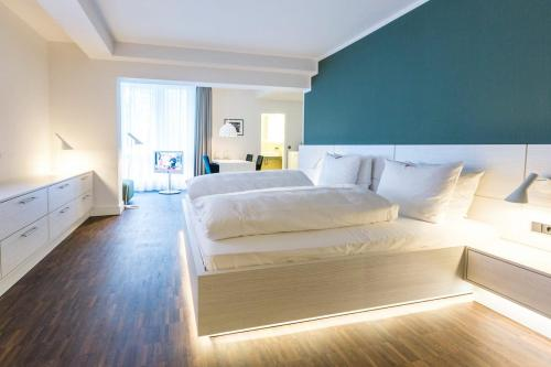 A bed or beds in a room at Altera Hotel