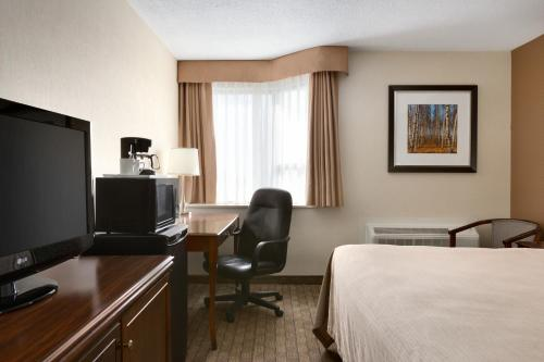 A television and/or entertainment center at Travelodge by Wyndham Toronto East