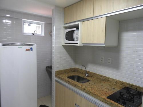 A kitchen or kitchenette at Jardins do Atlântico