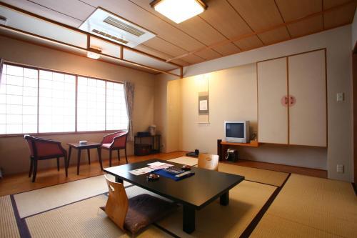 A seating area at Takinoya Bekkan Tamanoyu