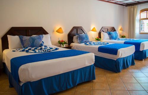 Кровать или кровати в номере El Tucano Resort & Thermal Spa