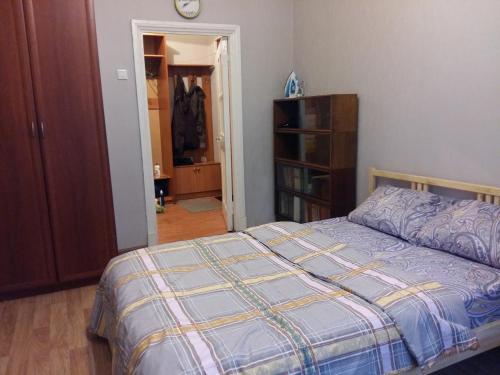 Кровать или кровати в номере Измайловский проезд 4