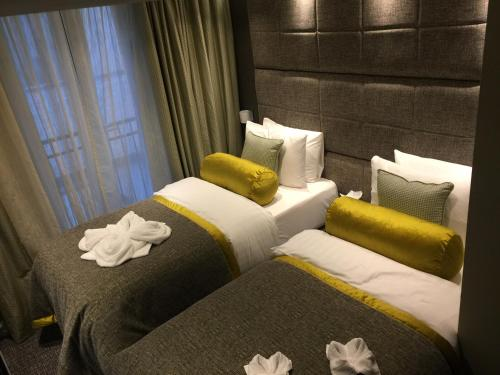 A bed or beds in a room at Mornington Hotel London Victoria