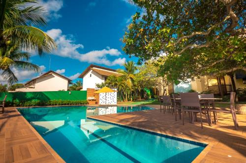 The swimming pool at or close to Pousada Villa Maeva Itacimirim