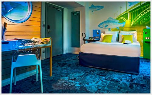 A bed or beds in a room at ibis Styles Strasbourg Avenue du Rhin