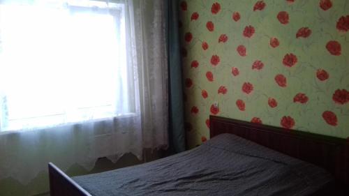 Кровать или кровати в номере Апартаменты на Ленинградской