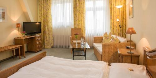 Ein Bett oder Betten in einem Zimmer der Unterkunft Hotel Union