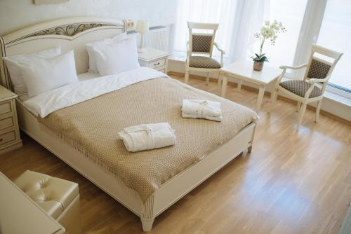 A bed or beds in a room at Svityaz Resort