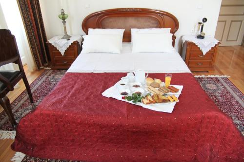 A bed or beds in a room at Hotel Panellinion