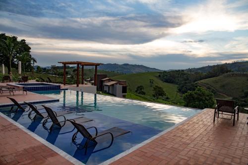 The swimming pool at or near Pousada Estância das Montanhas