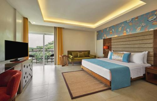 A television and/or entertainment center at Movenpick Resort & Spa Boracay
