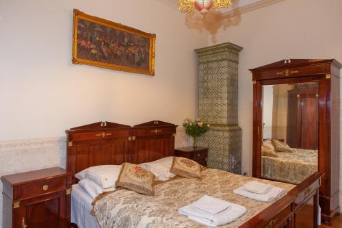 Łóżko lub łóżka w pokoju w obiekcie Metropolitan Apartments