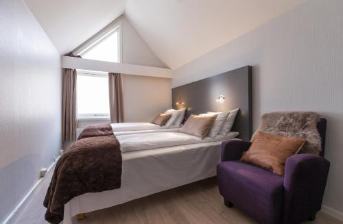 سرير أو أسرّة في غرفة في فندق إنتر فايكنغ
