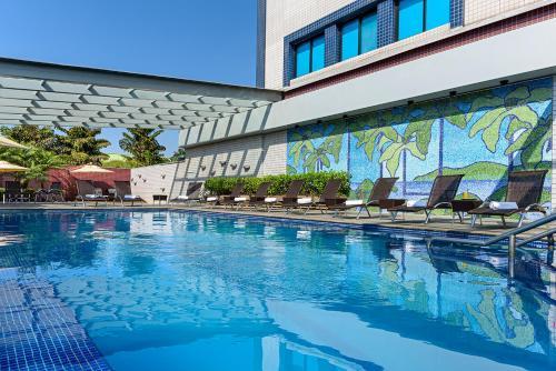 The swimming pool at or near Novotel Sao Paulo Center Norte