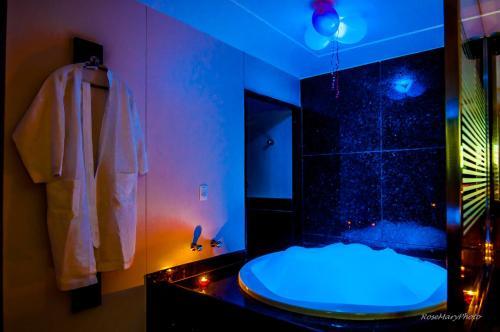 Um banheiro em Toulouse Motel (Adult Only)