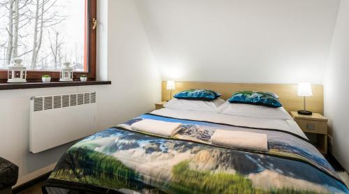 Łóżko lub łóżka w pokoju w obiekcie Rent like home - Strzelców 24C