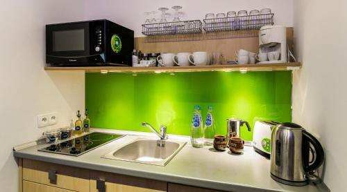 Kuchnia lub aneks kuchenny w obiekcie Rent like home - Strzelców 24C