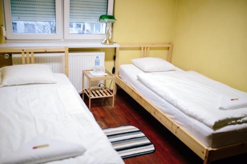 Łóżko lub łóżka w pokoju w obiekcie Solec 28 Apartament