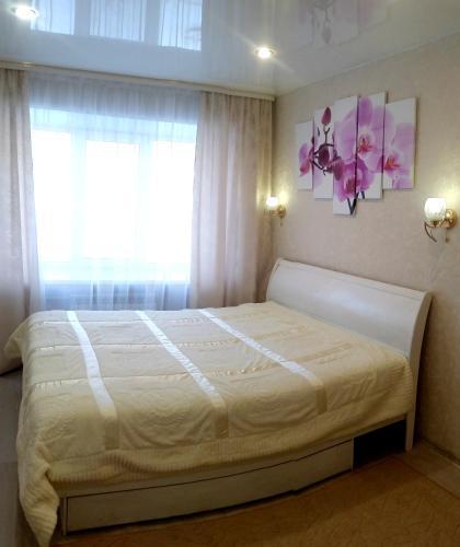 Кровать или кровати в номере Apartment on Blyuhera