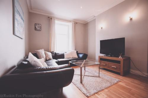 A seating area at Charming one bedroom