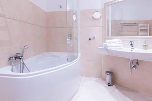 Ванная комната в Unitas Hotel