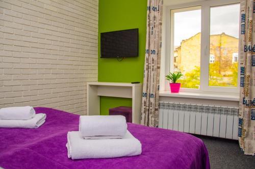 מיטה או מיטות בחדר ב-Good Night Hotel