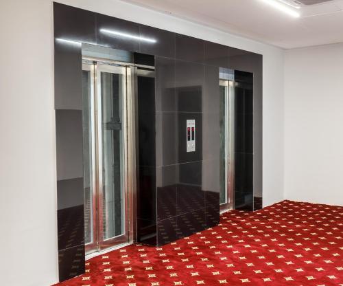 Кровать или кровати в номере Central City Hotel Makhachkala