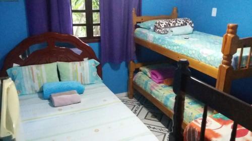 A bed or beds in a room at Pousada Do Pedrão