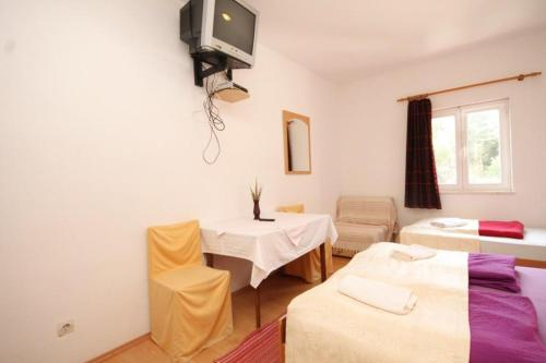A bed or beds in a room at Apartments with a swimming pool Mlini, Dubrovnik - 8579