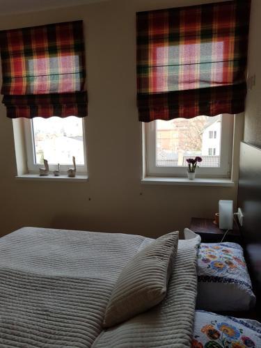 Łóżko lub łóżka w pokoju w obiekcie Kamienica Bory