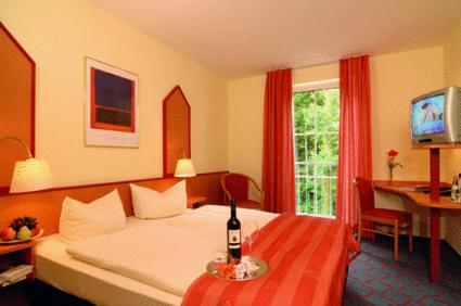 A bed or beds in a room at Montana Hotel Senden
