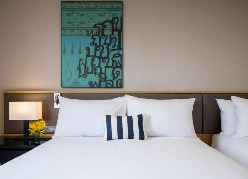 A bed or beds in a room at Travelodge Sukhumvit 11