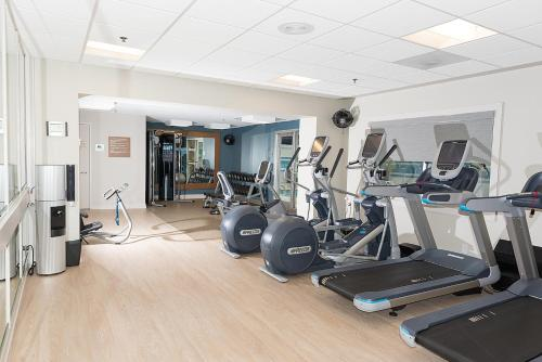 The fitness center and/or fitness facilities at DoubleTree by Hilton Charlotte Gateway Village