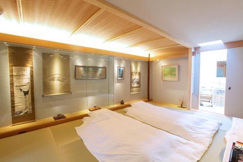 Luxury Condo Shikine An Gion Shirakawaにあるベッド