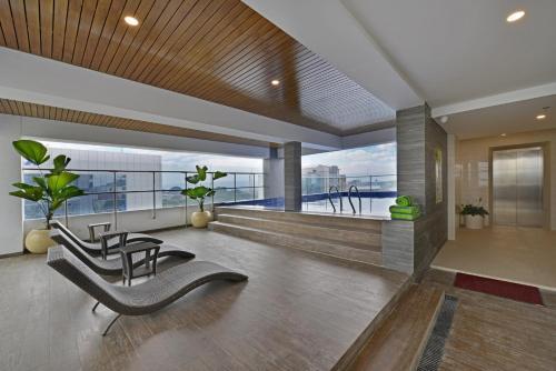 The lobby or reception area at Whiz Prime Hotel Basuki Rahmat Malang