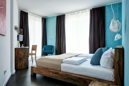 A bed or beds in a room at Almodovar Hotel Berlin - Biohotel