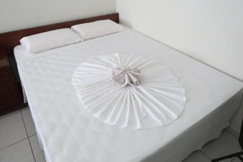 A bed or beds in a room at Hotel Monalisa